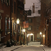 Romantic Boston winter photography of old colonial brick row houses along Acorn Street on a beautiful winter evening. Acorn Street near Louisburg Square is one of the most prestigious address in Beacon Hill. Street lanterns provide the warm night light in Beacon Hill. Acorn Street, often mentioned as the most frequently photographed street in the United States of America. It is a narrow lane paved with cobblestones that was home to coachmen employed by families in Mt. Vernon and Chestnut Street mansions.<br /> <br /> This Boston winter photography image of historic Acorn Street in Beacon Hill is available as museum quality photography prints, wood prints, canvas prints, acrylic prints or metal prints. Prints may be framed and matted to the individual liking and wall decoration needs: <br /> <br /> http://juergen-roth.pixels.com/featured/chilly-boston-juergen-roth.html<br /> <br /> Good light and happy photo making!<br /> <br /> My best,<br /> <br /> Juergen<br /> Prints: http://www.rothgalleries.com<br /> Photo Blog: http://whereintheworldisjuergen.blogspot.com<br /> Twitter: @NatureFineArt<br /> Instagram: https://www.instagram.com/rothgalleries<br /> Facebook: https://www.facebook.com/naturefineart