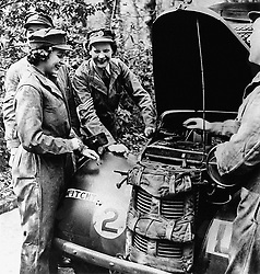 Embargoed to 2100 Friday May 08 File photo dated 01/01/45 of Queen Elizabeth II, then Princess Elizabeth learning vehicle maintenance on an Austin 10 Light Utility Vehicle while serving with No 1 MTTC at Camberley, Surrey. The Queen was surrounded by historic personal mementos from the war years as she addressed the nation on the 75th anniversary of VE Day.