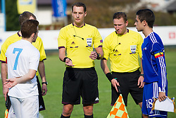 Dino Hotic of Slovenia, referees Andreas Ekberg and Mehmet Culum and Victor Calvino of Andorra during football game between Slovenia and Andorra of<br /> UEFA Under19 Championship Qualifications, on October 15, 2013 in Bakovci, Slovenia. (Photo by Erik Kavas / Sportida)
