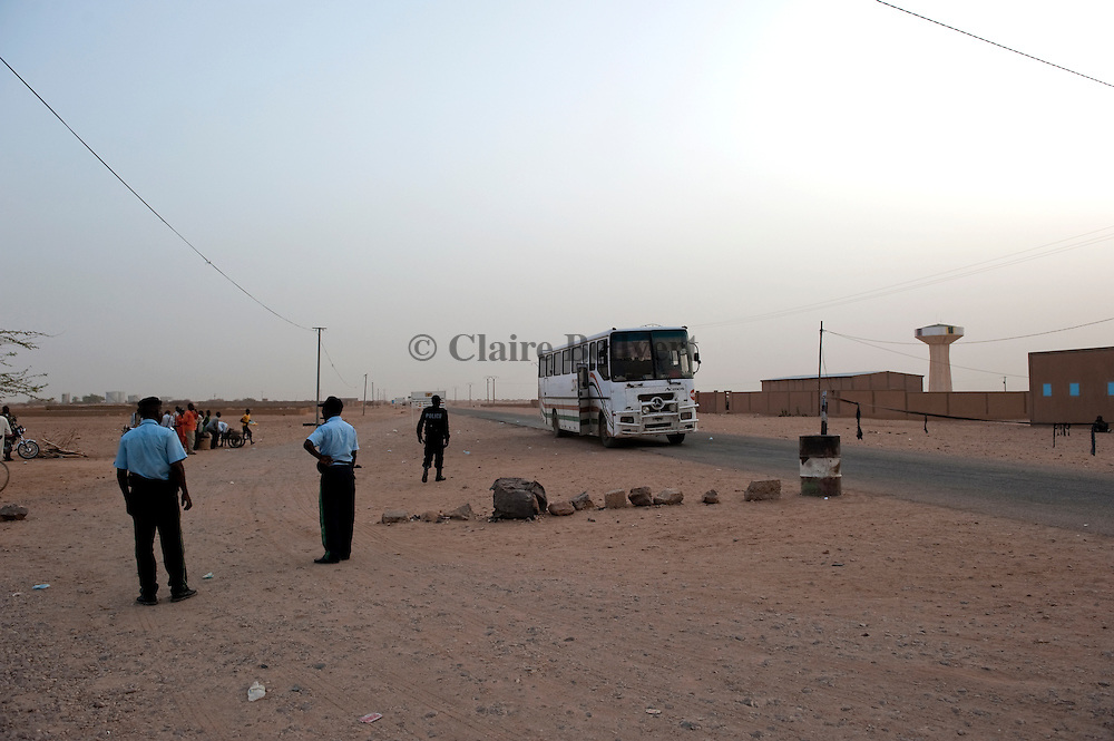 Nigerien polimen standing at the entrance of Agadez city, waiting for the bus, plenty of african migrants coming for example from Mali, Burkina, Cameroun, Nigeria, Ghana...migrants are forced to pay them at least 10 000 CFA to be allowed into the city.