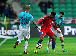 Daniel Sturridge of England between Aljaz Struna of Slovenia and Miral Samardzic of Slovenia during football match between National teams of Slovenia and England in Round #3 of FIFA World Cup Russia 2018 Qualifier Group F, on October 11, 2016 in SRC Stozice, Ljubljana, Slovenia. Photo by Vid Ponikvar / Sportida