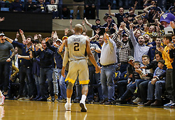 Feb 26, 2018; Morgantown, WV, USA; West Virginia Mountaineers fans celebrate after West Virginia Mountaineers guard Jevon Carter (2) made a three pointer during the first half against the Texas Tech Red Raiders at WVU Coliseum. Mandatory Credit: Ben Queen-USA TODAY Sports