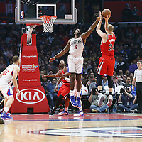 12 December 2016: Portland Trail Blazers center Mason Plumlee (24) takes a jump shot over LA Clippers center DeAndre Jordan (6) during the LA Clippers 121-120 victory over the Portland Trail Blazers, at the Staples Center, Los Angeles, California, USA.