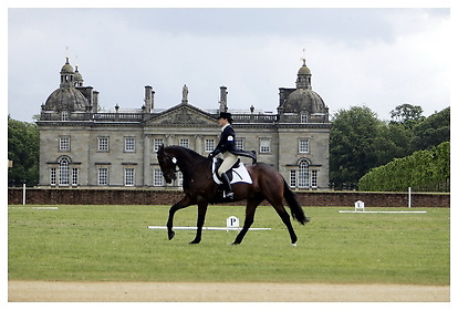 Houghton International Horse Trials.22-05-2009.Dressage with Houghton Hall in background.