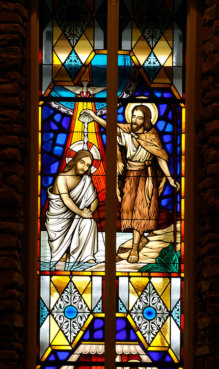 Jesus is baptized by John the Baptist. Stained glass image from St. Anthony Church, Menomonee Falls, Wis. (Photo by Sam Lucero)<br />
