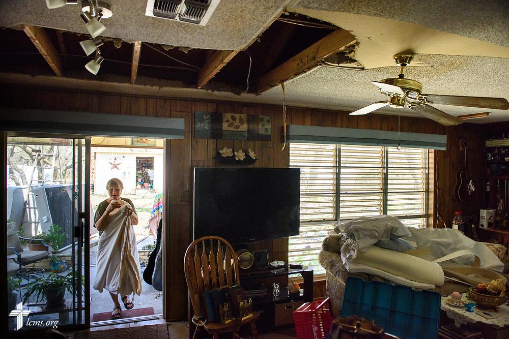 Mary Jane McKay, member of Peace Lutheran Church, Rockport, Texas, walks into her home, which was damaged several days prior by Hurricane Harvey, on Thursday, Aug. 31, 2017, in Rockport. LCMS Communications/Erik M. Lunsford