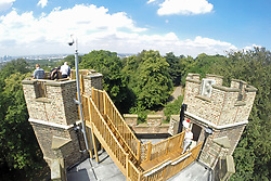 © Licensed to London News Pictures. 18/07/2014. An 18th century castle on a hill in south east London is preparing to reopen this weekend following a lengthy, painstaking restoration project. Severndroog Castle in Oxleas Woods on Shooters Hill enjoys stunning views across seven counties on a clear day. The folly has been closed for many years and was in state of disrepair before work started on a restoration project last year. The historic building featured in the BBC series Restoration in 2004. The reopening takes place on Sunday July 20th - more information about the castle and the reopening available fron the Severndroog Castle Building Presevation Trust. http://www.severndroogcastle.org.uk/index.html Credit : Rob Powell/LNP