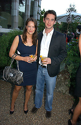 ARABELLA MUSGRAVE and the HON.JAMES TOLLEMACHE at a party to celebrate Stephen Jones's 25 Years of Millinery held at Debenham House, 8 Addison Road, London W14 on 13th July 2006.<br />