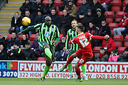 Jack Payne of Leyton Orient clears the ball before Bayo Akinfenwa of AFC Wimbledon gets there during Sky Bet League 2 match between Leyton Orient and AFC Wimbledon at the Matchroom Stadium, London, England on 28 November 2015. Photo by Stuart Butcher.