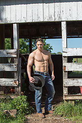hot muscular cowboy on a ranch without a shirt shirtless cowboy on a ranch