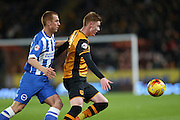 Hull City midfielder Sam Clucas (11) holds off Brighton midfielder Steve Sidwell (36) during the Sky Bet Championship match between Hull City and Brighton and Hove Albion at the KC Stadium, Kingston upon Hull, England on 16 February 2016.