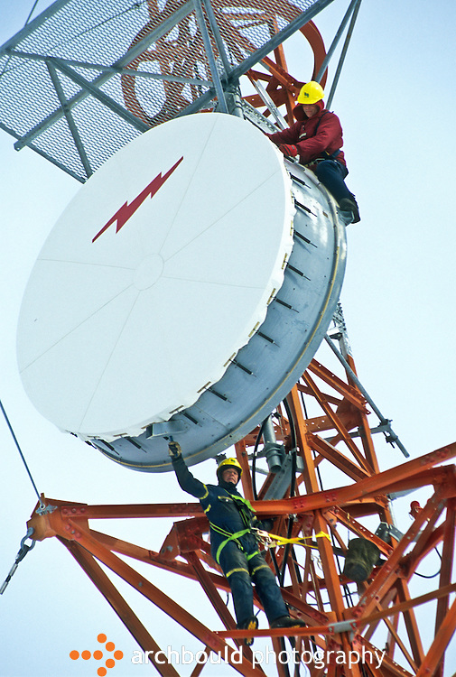 Workers work on Communications tower in a Yukon winter.<br /> <br /> NOT IN YOUR BUDGET? Contact Cathie for a price specific to your project.