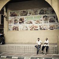 Men take a break in downtown Kuala Lumpur