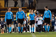 Referees and teams walk onto the field at the FFA Cup Round 16 soccer match between APIA Leichhardt Tigers FC and Melbourne Victory at Leichhardt Oval in Sydney on August 21, 2018.