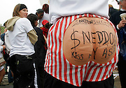 A Michael Jackson fan wearing a rubber rear end stands outside the court in Santa Maria, California where his trial is taking place June 2, 2005. The writing refers to the Santa Barbara District Attorney prosecuting the case Tom Sneddon.  Closing arguments began in the Jackson sex abuse trial, the final showdown between prosecutors and defense lawyers in a bitter, four-month court fight that could end in prison for one of the world's best-known entertainers.