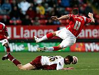 Photo: Tom Dulat/Sportsbeat Images.<br /> <br /> Charlton Athletic v Burnley. Coca Cola Championship. 01/12/2007.<br /> <br /> Chris McCann of Burnley gets the ball away from Charlton Athletic's Darren Ambrose.