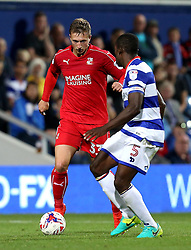 Luke Norris of Swindon Town takes on Nedum Onuoha of Queens Park Rangers - Mandatory by-line: Robbie Stephenson/JMP - 10/08/2016 - FOOTBALL - Loftus Road - London, England - Queens Park Rangers v Swindon Town - EFL League Cup