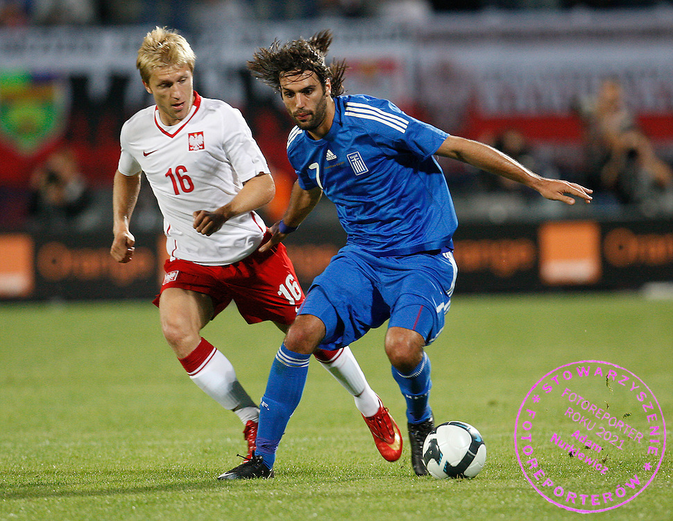 BYDGOSZCZ 12/08/2009.INTERNATIONAL FRIENDLY .POLAND v GREECE.GEORGIOS SAMARAS OF GREECE AND KUBA BLASZCZYKOWSKI OF POLAND ..PHOT: PIOTR HAWALEJ / WROFOTO