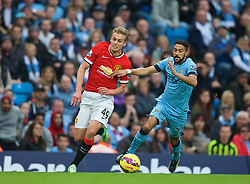 MANCHESTER, ENGLAND - Sunday, November 2, 2014: Manchester City's Gael Clichy in action against Manchester United's James Wilson during the Premier League match at the City of Manchester Stadium. (Pic by David Rawcliffe/Propaganda)