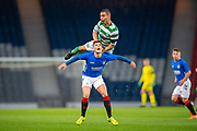 Dylan Forrest (#2) of Celtic FC outjumps Joshua McPake (#11) of Rangers FC during the Scottish FA Youth Cup Final match between Celtic and Rangers at Hampden Park, Glasgow, United Kingdom on 25 April 2019.