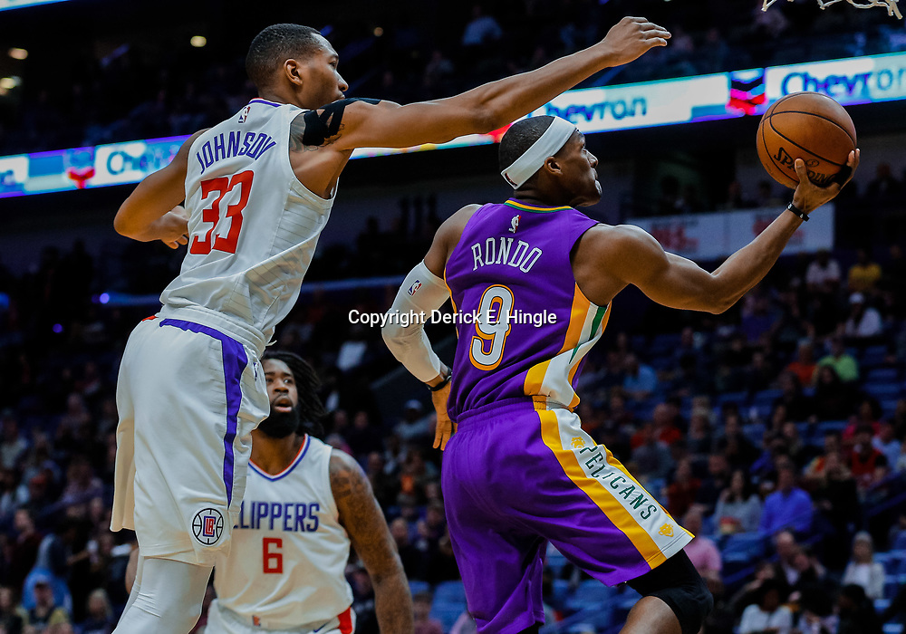 Jan 28, 2018; New Orleans, LA, USA; New Orleans Pelicans guard Rajon Rondo (9) shoots over LA Clippers forward Wesley Johnson (33) during the third quarter at the Smoothie King Center. The Clippers defeated the Pelicans 112-103. Mandatory Credit: Derick E. Hingle-USA TODAY Sports