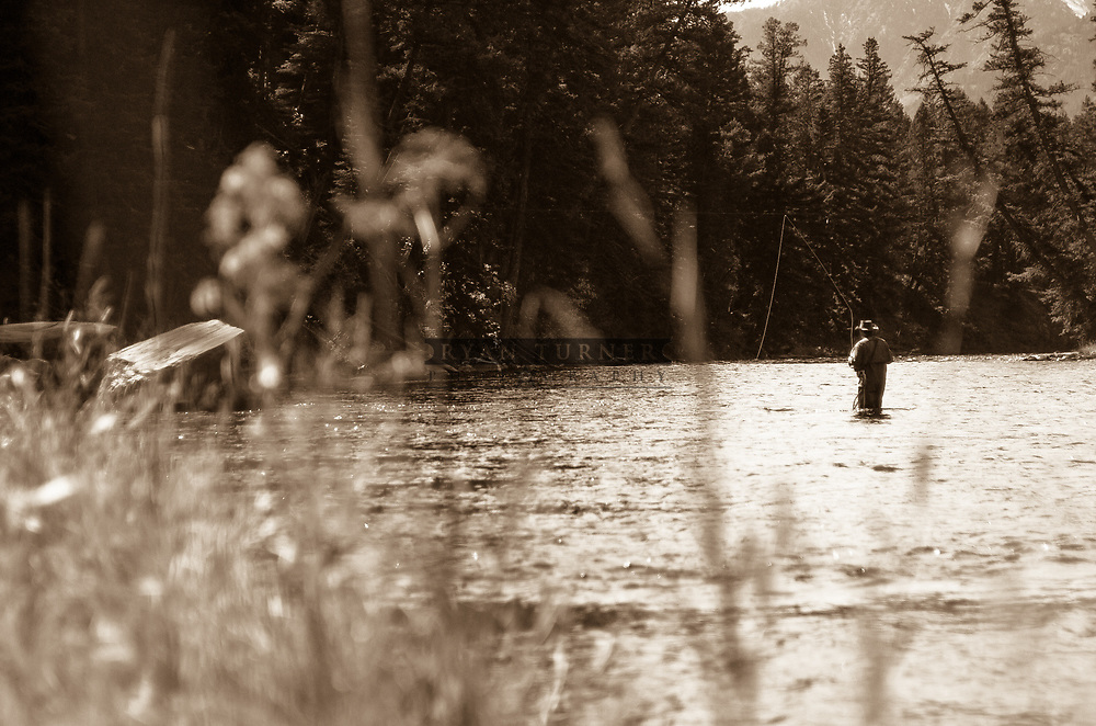 A man fly fishing in a river in Montana. Limited Edition - 75