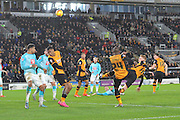 Hull City midfielder Sone Aluko tries desperate high kick at goal but gores over the bar  during the Sky Bet Championship match between Hull City and Derby County at the KC Stadium, Kingston upon Hull, England on 27 November 2015. Photo by Ian Lyall.