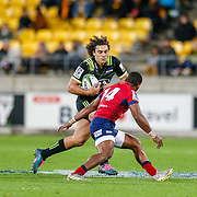 Peter Umaga-Jensen runs during the Super rugby union game (Round 14) played between Hurricanes v Reds, on 18 May 2018, at Westpac Stadium, Wellington, New  Zealand.    Hurricanes won 38-34.
