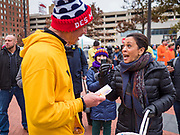 28 NOVEMBER 2019 - DES MOINES, IOWA: US Senator KAMALA HARRIS (D-CA), right, talks to ZACK DARBY, a senior advisor for her campaign, after he ran the Turkey Trot. The Turkey Trot is an annual Des Moines Thanksgiving Day 5 mile fun run. Sen. Harris greeted runners in the finish area and handed out cookies. She is running to be the Democratic nominee for the US Presidency in 2020. Iowa hosts the first selection event of the presidential election season. The Iowa caucuses are February 3, 2020.              PHOTO BY JACK KURTZ