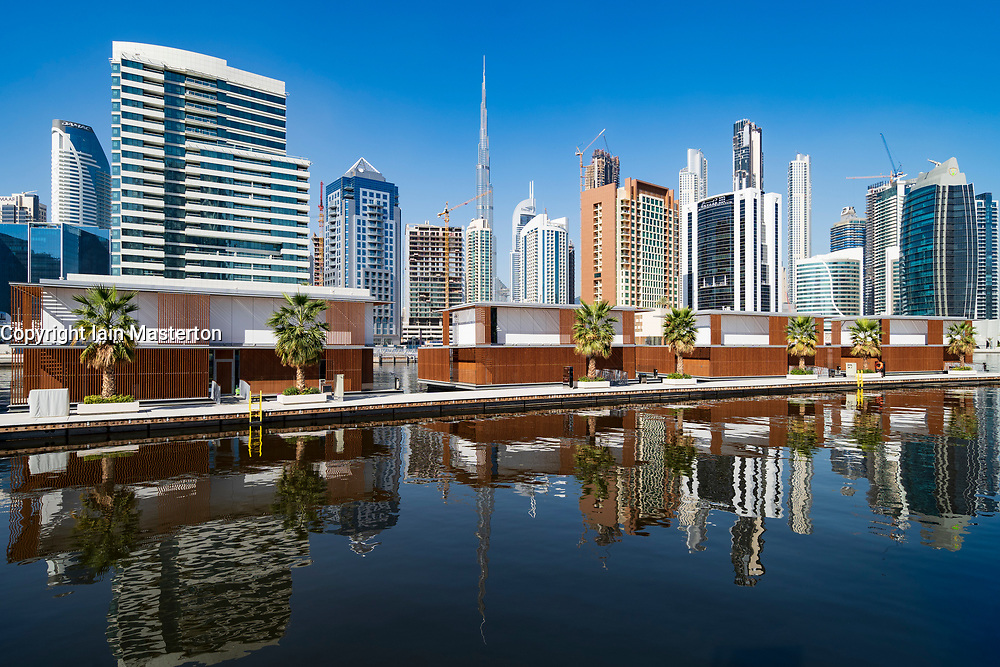 Modern skyline and new floating villas on The Creek in Business Bay in Dubai, United Arab Emirates