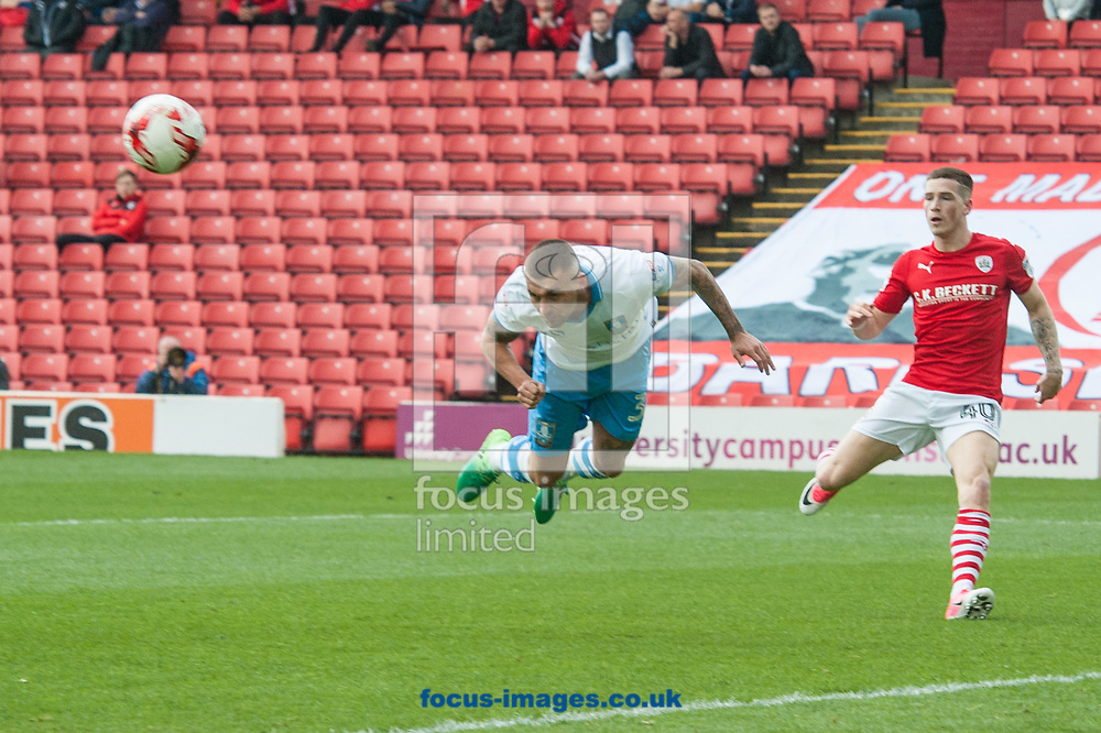 David Jones of Sheffield Wednesday clears with a diving header during the Sky Bet Championship match at Oakwell, Barnsley<br /> Picture by Matt Wilkinson/Focus Images Ltd 07814 960751<br /> 01/04/2017