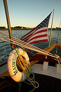 USA, Newport, RI - A lifering and American flag adorn the stern of the schooner Madeline sailing in Narragansett Bay.