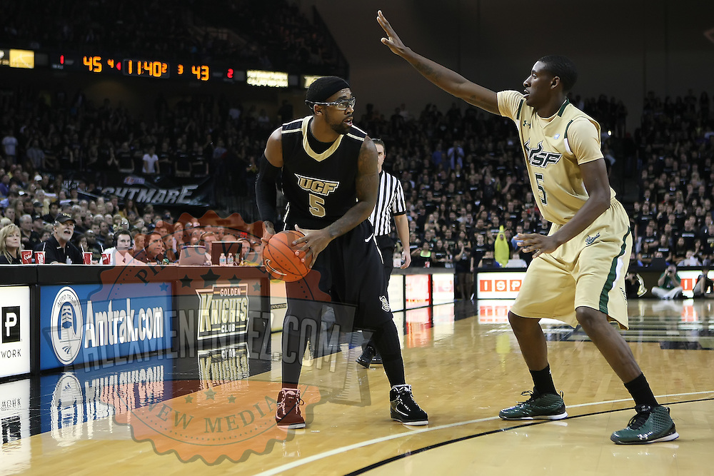 Central Florida guard Marcus Jordan (5) holds the ball against Jawanza Poland  during the NCAA basketball game against the USF Bulls at the UCF Arena on November 18, 2010 in Orlando, Florida. UCF won the game 65-59. (AP Photo/Alex Menendez)