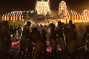 SRI LANKA..Udappuwa festival, the preparation for the fire walking. The pit is prepared. The burning wood levelled, the embers shaped into a rectangular pit.