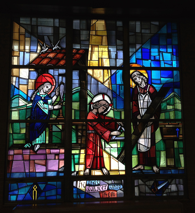 Stained glass depicting Jesus learning carpentry skills with Joseph. Taken with iPhone5 at Holy Rosary Church in Kewaunee. (Sam Lucero photo)
