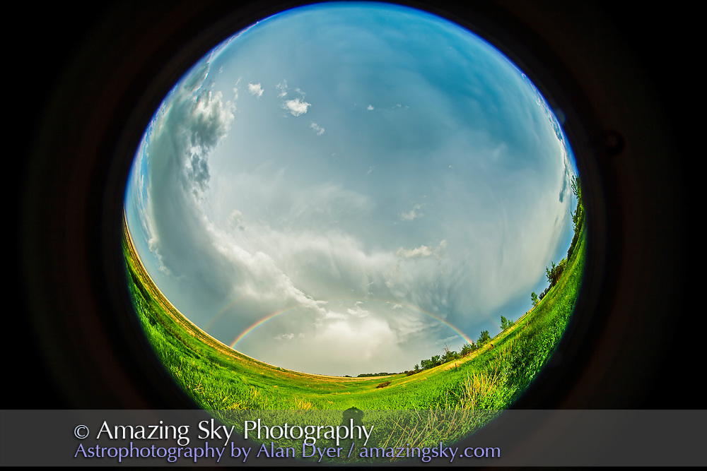 A fish-eye image of a receding thunderstorm and rainbow, June 17, 2013, from home in southern Alberta. Taken with the 8mm Sigma fish-eye and Canon 5D MkII camera.