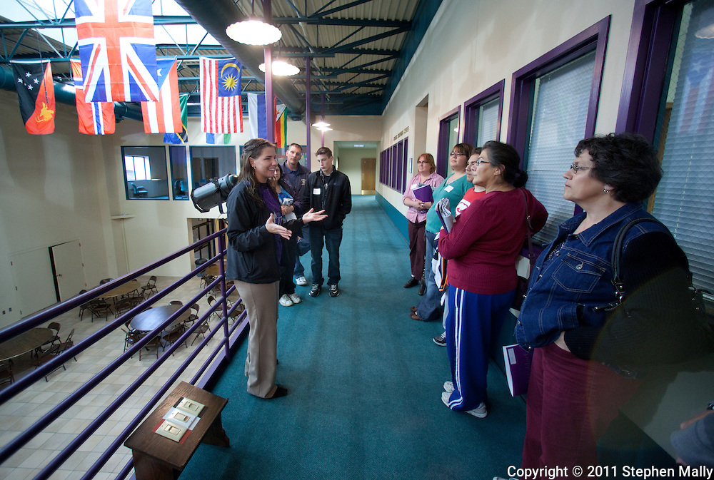 Trinity Renchin (right), student ambassador, leads a tour of prospective students and their parents during an open house at Waldorf College in Forest City, Iowa on Saturday, May 14, 2011.