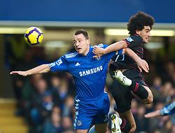 LONDON, ENGLAND - Saturday, December 12, 2009: Everton's Marouane Fellaini and Chelsea's captain John Terry during the Premiership match at Stamford Bridge. (Photo by David Rawcliffe/Propaganda)