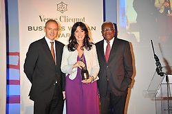 Left to right, GRAHAM BOYES, GAIL REBUCK and SIR TREVOR MACDONALD at the presentation of the Veuve Clicquot Business Woman Award 2009 hosted by Graham Boyes MD Moet Hennessy UK and presented by Sir Trevor Macdonald at The Saatchi Gallery, Duke of York's Square, Kings Road, London SW1 on 28th April 2009.