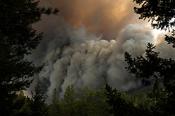September 12, 2015 - Lake County, California. Smoke and flames erupted in Boggs Mountain State Forest shortly after the Valley Fire started,  viewed from Loch Lomond. (Kim Ringeisen / Polaris)