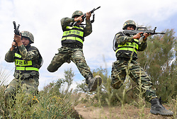 June 27, 2017 - Xinjiang Uygur, China - Soldiers participate in a joint anti-terrorist exercise held by China and Kyrgyzstan frontier forces in Kizilsu Kirgiz Prefecture, northwest China's Xinjiang Uygur Region. The drill, carried out under the framework of the Shanghai Cooperation Organization (SCO), was witnessed by representatives from Kazakhstan, China, Kyrgyzstan, Russia, Tajikistan and Uzbekistan, all the SCO member countries. (Credit Image: © Wang Fei/Xinhua via ZUMA Wire)