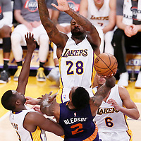 06 November 2016: Phoenix Suns guard Eric Bledsoe (2) goes for the jump shot against Los Angeles Lakers forward Luol Deng (9), Los Angeles Lakers center Tarik Black (28) and Los Angeles Lakers guard Jordan Clarkson (6) during the LA Lakers 119-108 victory over the Phoenix Suns, at the Staples Center, Los Angeles, California, USA.
