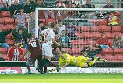 SOUTHAMPTON, WALES - Saturday, October 9, 2010: Tranmere Rovers' goalkeeper Peter Gulacsi is beaten by Southampton's Richard Lambert for the opening goal during the Football League One match at the St Mary's Stadium. (Pic by David Rawcliffe/Propaganda)