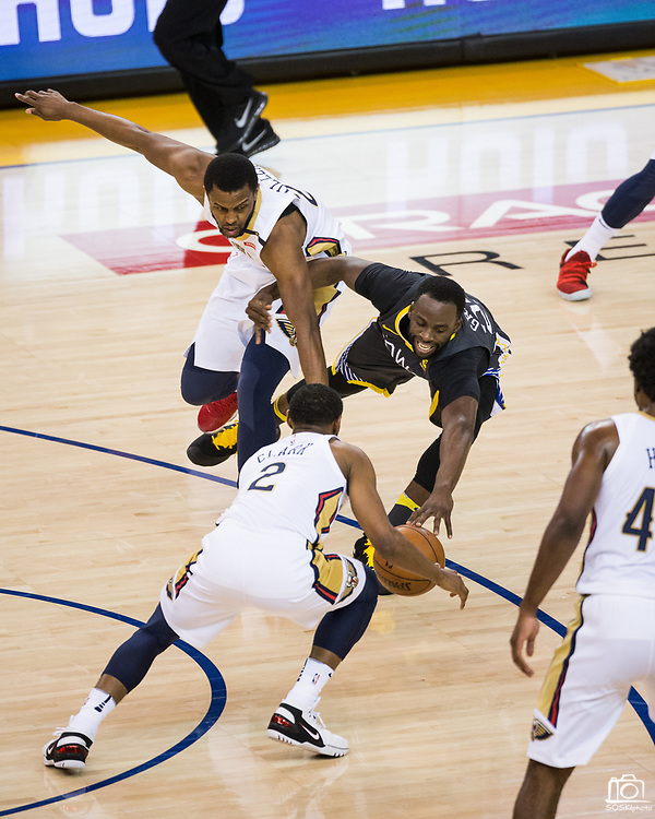 Golden State Warriors forward Draymond Green (23) dives for a loose ball against the New Orleans Pelicans at Oracle Arena during Game 2 of the Western Semifinals in Oakland, California, on May 1, 2018. (Stan Olszewski/Special to S.F. Examiner)