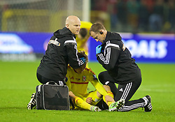 BRUSSELS, BELGIUM - Sunday, November 16, 2014: Wales' George Williams is treated for a head injury by physiotherapist Sean Connelly and Medical Officer Doctor Jon Houghton during the UEFA Euro 2016 Qualifying Group B game against Belgium at the King Baudouin [Heysel] Stadium. (Pic by David Rawcliffe/Propaganda)