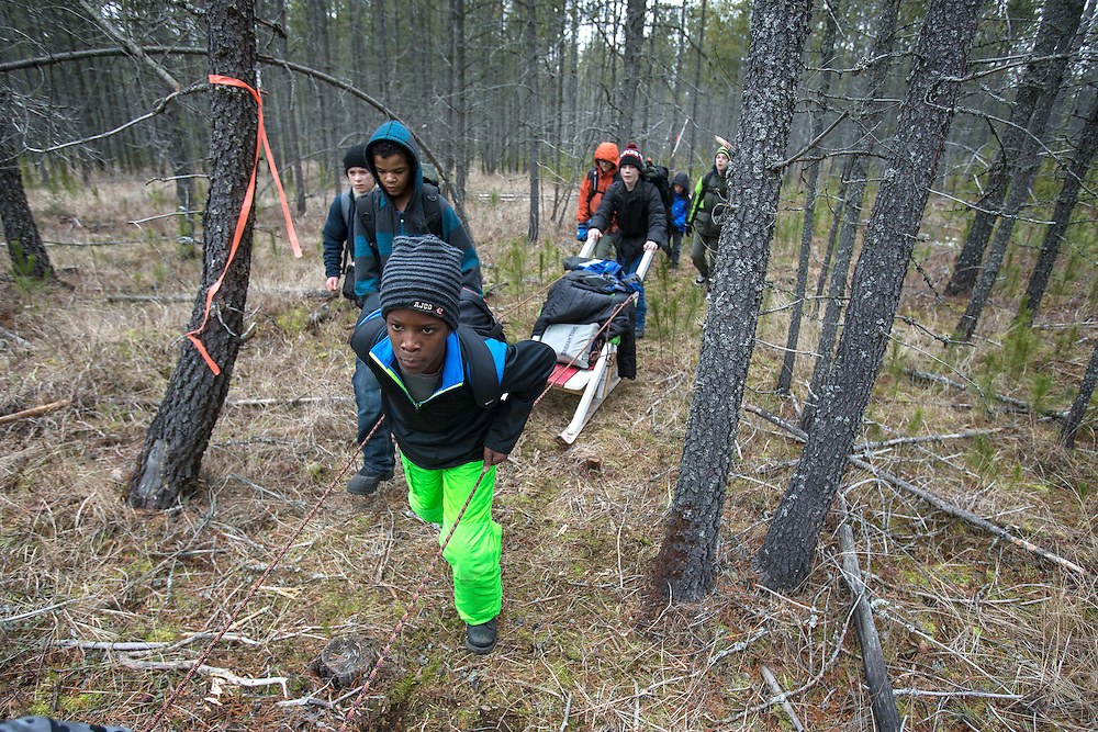GABE GREEN/Press<br /> <br /> Trey McArthur, 12, a Boyscout with Coeur d&rsquo;Alene troop 209, helps pull the troop&rsquo;s Klondike sleep through a wooded area just East of Silverwood Theme Park Saturday during the Klondike Derby. Scouts were required to demonstrate their skills in survival, teamwork and preparedness in order to earn points to compete with other Inland Northwest troops.