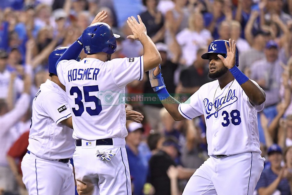 August 8, 2017 - Kansas City, MO, USA - The Kansas City Royals' Jorge Bonifacio (38), Eric Hosmer (35) and Melky Cabrera score on a double by Cheslor Cuthbert in the fourth inning against the St. Louis Cardinals at Kauffman Stadium in Kansas City, Mo., on Tuesday, Aug. 8, 2017. (Credit Image: © John Sleezer/TNS via ZUMA Wire)