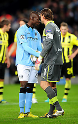 Borussia Dortmund's Roman Weidenfeller tries to distract Manchester City's Mario Balotelli as he steps up for a last minute penalty - Photo mandatory by-line: Joe Meredith/JMP  - Tel: Mobile:07966 386802 03/10/2012 - Manchester City v Borussia Dortmund - SPORT - FOOTBALL - Champions League -  Manchester   - Etihad Stadium -