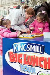 The Kingsmill Big Lunch Tour reaches Sheffield and puts the fun back into lunchtimes as Anca(7) & Dianna (4) Nicula try their hand at sandwich making with the help of mum in Fargate Sheffield on Wednesday...http://www.pauldaviddrabble.co.uk.11 April 2012 .Image © Paul David Drabble