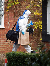 © under license to London News pictures.  03/10/2010.The search continues for the body of murder suspect Joanna Brown who disappeared from her multi-million pound home in Ascot, Berkshire. Pictured is a forensics officer carrying evidence bags and camera equipment.